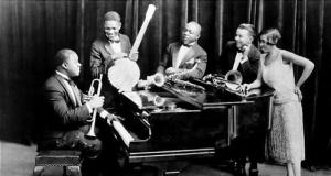 Louis Armstrong and his Hot Five , 1926 . Left to right : Louis Armstrong at piano holding trumpet , Johnny St . Cyr with banjo , Johnny Dodds , Kid Ory , Lil Hardin Armstrong . American jazz band . Louis Armstrong , jazz trumpeter , singer , born 4 August 1901 , died 6 July 1971 . Hardin Armstrong , jazz pianist , composer , arranger , singer , born 3 February 1898 , died 27 August 1971 .  Jazz band . Editorial use only